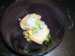 Top tofu with daikon pulp and spring onions